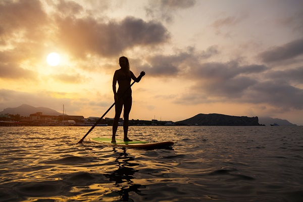 Woman on SUP board that is perfect for her.